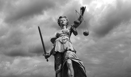 libra: Black and white Statue of justice goddess (Justitia) with cloudy sky background