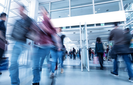 blurred people: Global Trade Show Visitors in rush