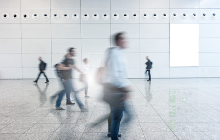 architecture abstract: Blurred businesspeople walking in a floor