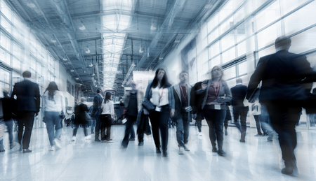 Blurred business people at a tradeshow Stock Photo