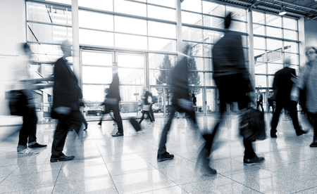Blurred business people at a International Exhibition walkway
