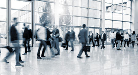 International Trade Fair visitors walking at a modern floor Stock Photo