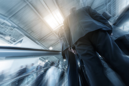 architecture abstract: Blurred business people at a escalator