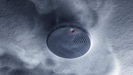 Fire alarm will be triggered with a smoke detector Stock Photo