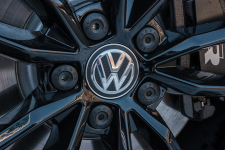 automaker: AACHEN, GERMANY JANUARY, 2017: Sign of a Volkswagen logo on a car rim .. Volkswagen is the biggest German automaker and the third large largest auto maker in the world. Editorial