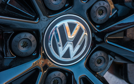 third world: AACHEN, GERMANY JANUARY, 2017: Sign of a Volkswagen logo on a car rim .. Volkswagen is a German automobile manufacturer and the biggest German automaker and the third large largest auto maker in the world. Editorial