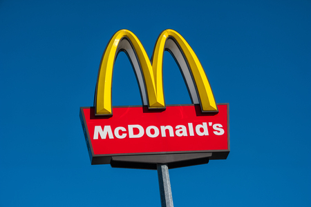 macdonald: Aaachen, GERMANY JANUARY, 2017: Closeup of the McDonalds restauraunt sign in germany. The McDonalds Corporation is the worlds large largest chain of hamburger fast food restaurants.