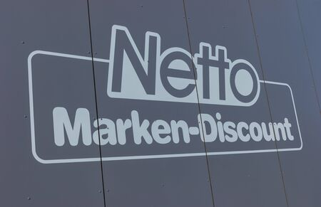 employing: AACHEN, GERMANY FEBRUARY, 2017: Net discount store Sign It is part of Edeka Group, large largest German supermarket corporation Employing 250,000 people.. Editorial