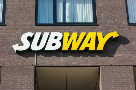 shop sign: HEERLEN, NETHERLANDS FEBRUARY, 2017: Subway fast food restaurant sign. Subway is an American fast food franchise offering sub sandwiches and salads.