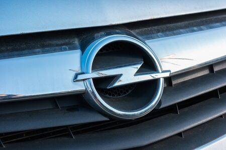 ag: AACHEN, GERMANY FEBRUARY, 2017: Opel sign at a silver car grill. Opel is a German automobile manufacturer headquartered in Germany, subsidiary of the American group General Motors.