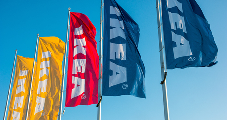 HEERLEN, NETHERLANDS FEBRUARY, 2017: IKEA flags against sky at the IKEA store. IKEA is the world's large largest furniture retailer and sells ready-to-assemble furniture. Founded in Sweden in 1943rd