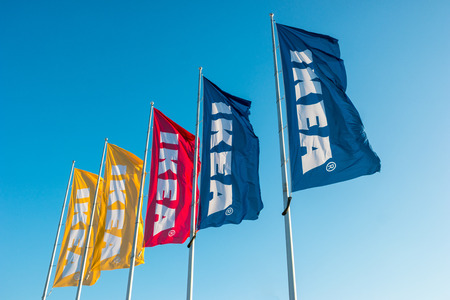 HEERLEN, NETHERLANDS FEBRUARY, 2017: IKEA flags against sky at the IKEA store. IKEA is the worlds large largest furniture retailer and sells ready-to-assemble furniture. Founded in Sweden in 1943rd