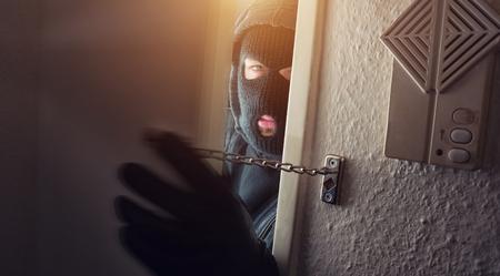 Burglar in mask at night