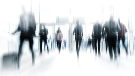 abstakt image of business people in the lobby with a blurred background