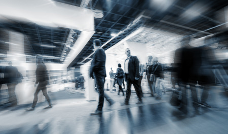 blurred people walking at a Trade Fair hall Stock Photo