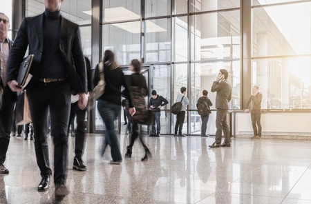business people walking in the corridor of at trade fair