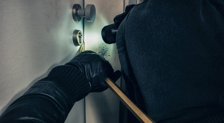 Criminal opens door with crowbar and Black Leather Gloves at Night