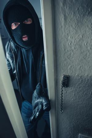 masked stalker at victim's home door