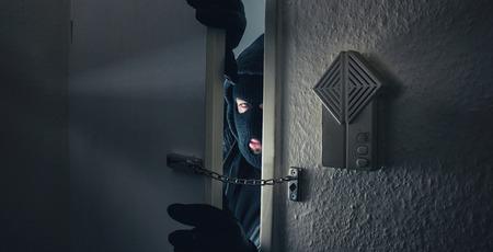 Burglar Breaking Into the House door at night