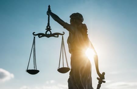 Statue of Justice symbol at sunlight