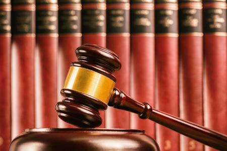 Judge gavel with defocussed law books behind
