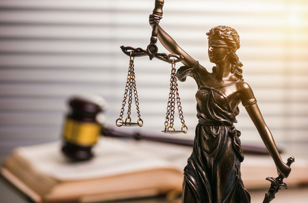 Judges Gavel with statue of justice Stock Photo