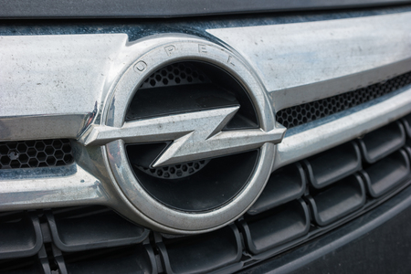 ag: AACHEN, GERMANY FEBRUARY, 2017: Dirty Opel logo on a car Grilll. Opel AG is a German automobile manufacturer.