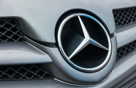 daimler: AACHEN, GERMANY FEBRUARY, 2017:. Mercedes Benz logo close up Mercedes-Benz is a German automobile manufacturer. The brand is used for luxury automobiles, buses, coaches and trucks.