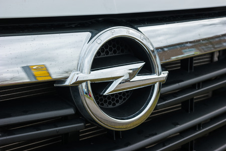 ag: AACHEN, GERMANY FEBRUARY, 2017: Opel logo on a car Grilll. Opel AG is a German automobile manufacturer and a subsidiary of the American General Motors Company.