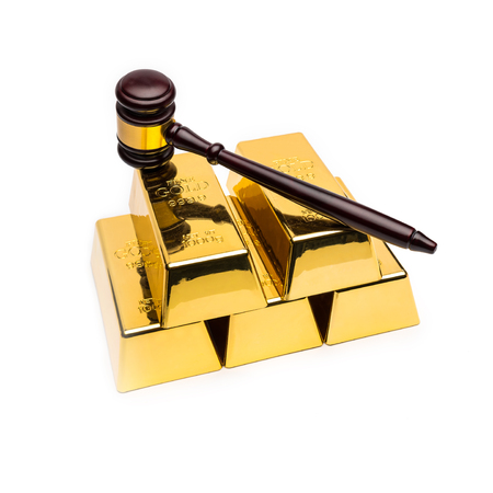 white bars: gold bars with wooden auction gavel on white background Stock Photo