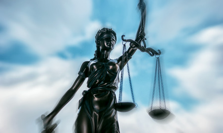 Scales of Justice Statue symbol - legal law concept