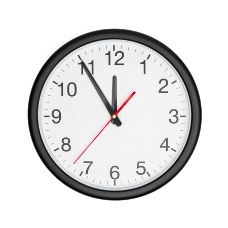 Five minutes to twelve on a wall clock on white background 版權商用圖片