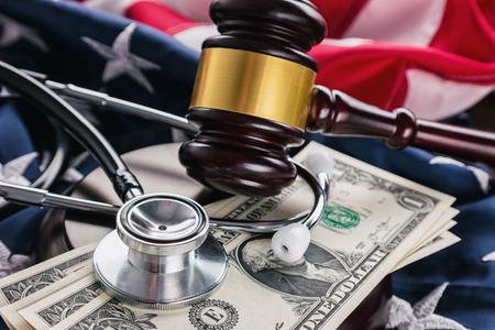 Judges Gavel And Medical Stethoscope on america flag Stock Photo
