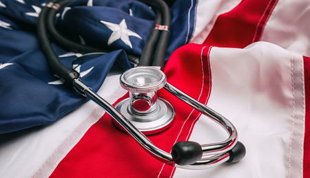 Close-up Photo Of Stethoscope On American USA Flag