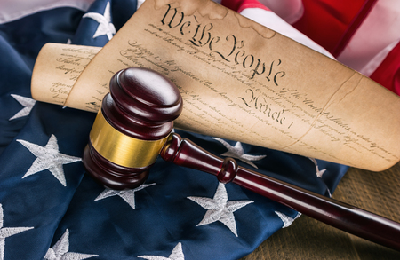 preamble: Constitution of america with judge gavel on a USA flag