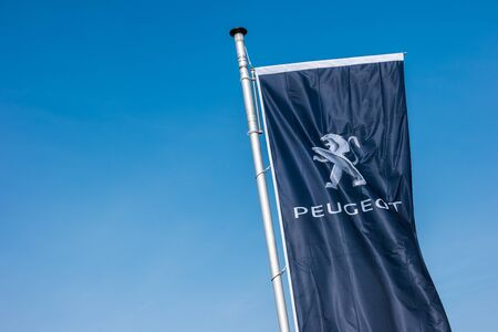 psa: AACHEN, GERMANY MARCH, 2017: Peugeot logo on a flag against blue sky. Peugeot is a French brand cars, part of PSA Peugeot Citroen. Editorial