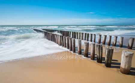 breakwater on a sandy beach in Zeeland, The Netherlands Stock Photo