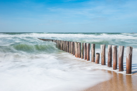 wave breakers with rough ocean waves at the beach Stock Photo