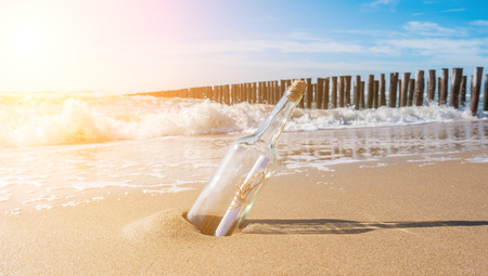 groynes: Message in a bottle on the beach with groynes
