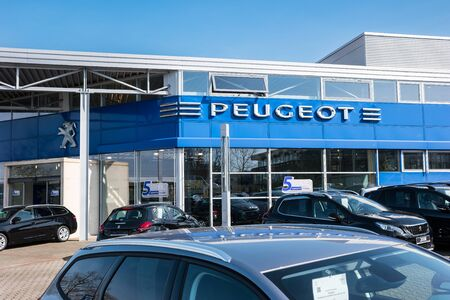 psa: AACHEN, GERMANY MARCH, 2017: Office of official Peugeot dealer. Peugeot is a French automobile manufacturer and part of Groupe PSA.
