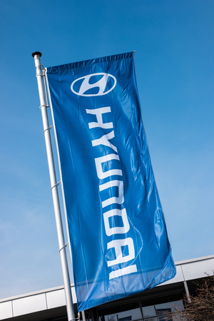 AACHEN, GERMANY MARCH, 2017: Hyundai flag against blue sky. Hyundai Motor Company is a South Korean multinational automotive manufacturer founded at 1967th Editorial