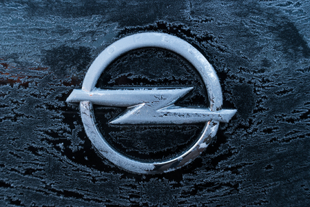 ag: AACHEN, GERMANY JANUARY, 2017: Frozen Opel logo on a car. Opel AG is a German automobile manufacturer. Editorial