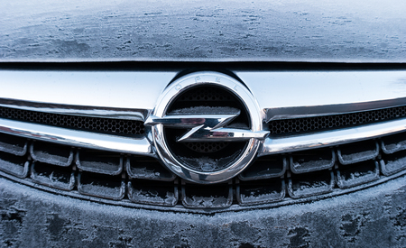 ag: AACHEN, GERMANY JANUARY, 2017: Frozen Opel logo on a car Grilll. Opel AG is a German automobile manufacturer.