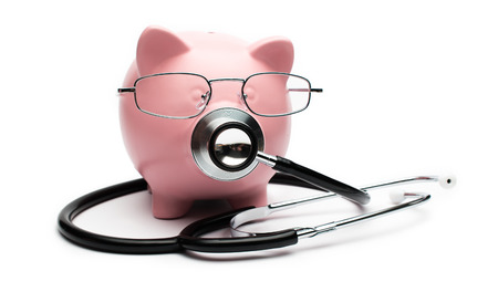 stethoscope and piggy bank showing medical or financial concept
