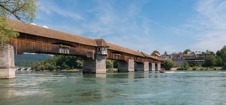 The historic woodbridge to Switzerland over Rhine river in Bad Saeckingen at summer, Black Forest, Baden-Wurttemberg, Germany, Europe