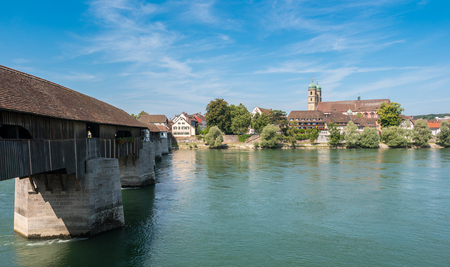 The Rhine river with the historic woodbridge and Fridolins minster in Bad Saeckingen at summer, Black Forest, Baden-Wurttemberg, Germany, Europe Stock Photo