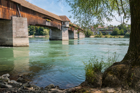 oldtown: View of the oldest wooden historic border bridge over Rhine river and view to Switzerland in Bad Saeckingen at summer, Black Forest, Baden-Wurttemberg, Germany, Europe