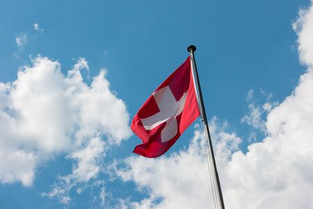 Swiss flag with Cloudy Sky
