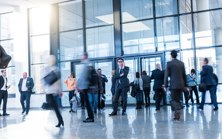 blurred people: Blurred people in business center Stock Photo