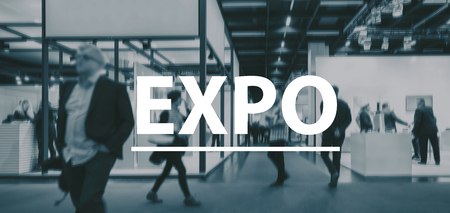 exhibitions: blurred Business people walking on a Expo - text Concept image Stock Photo